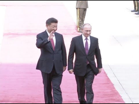 Chinese President Xi Jinping Welcomes Russian Counterpart's Visit