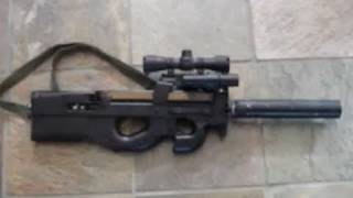 ruger 10 22 22lr rifle mounted in custom fn p90 airsoft stock