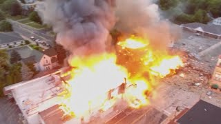 Gas explosion kills firefighter, levels buildings in Wisconsin