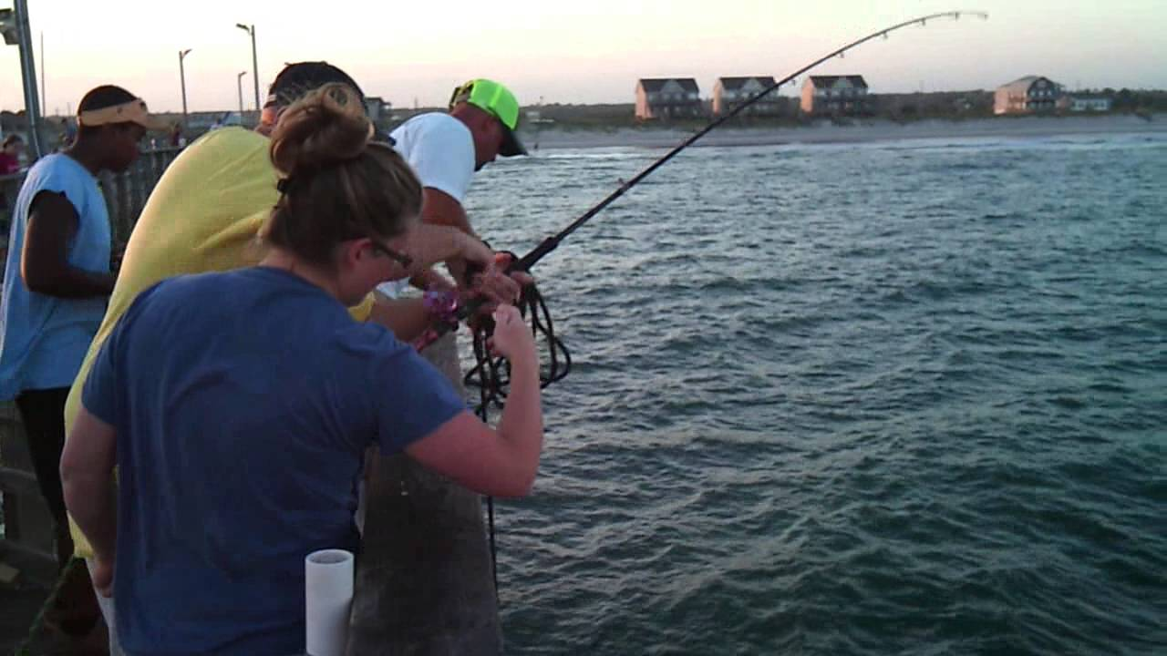 8 30 13 david and brandi catching a spanish mackerel off for Seaview fishing pier
