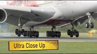 Airplanes Landing Gear Ultra Close Up footage Touchdown in Slow Motion