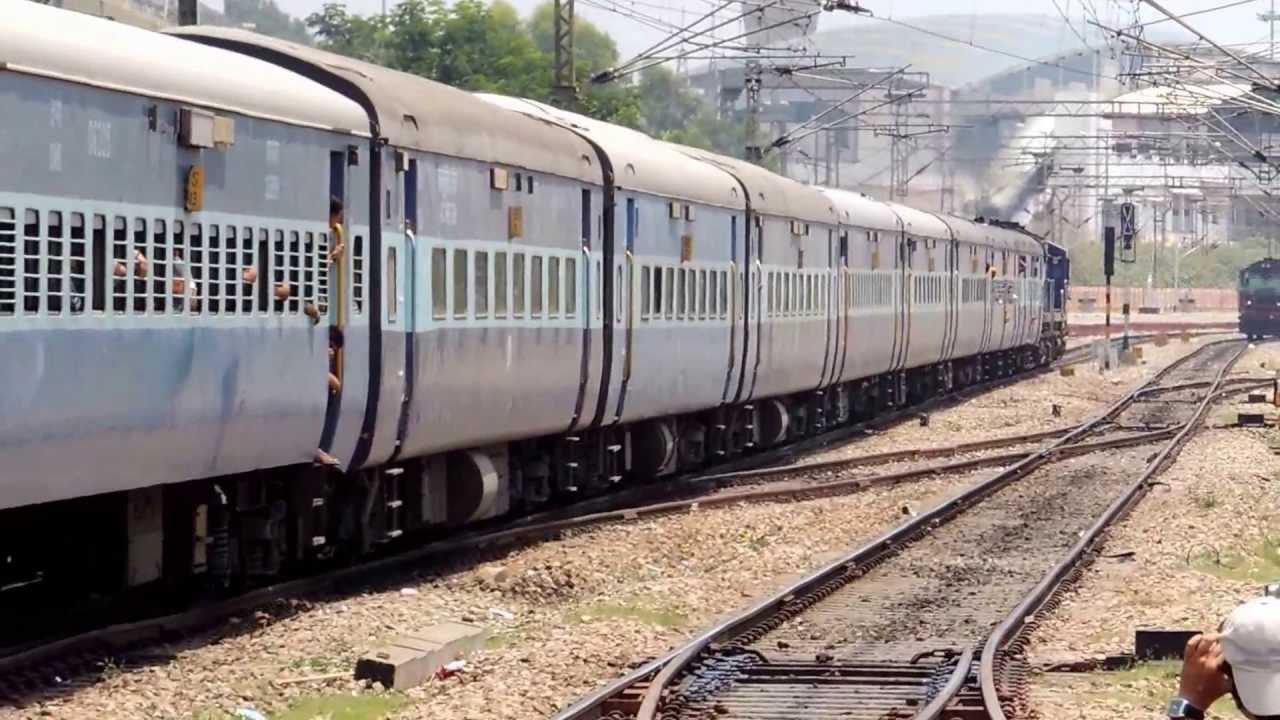 Train No 12628 Karnataka Express (King of SWR) with smoking twin ET alcos.