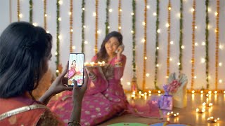 Beautiful Indian females celebrating Diwali festival while clicking pictures - festive background