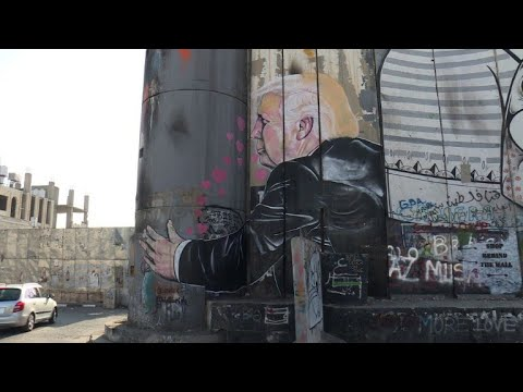 New Graffiti Of Trump On Separation Wall Attracts Tourists