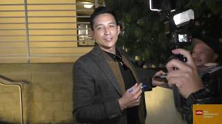 Gabriel Luna signs for fans outside the Terminator