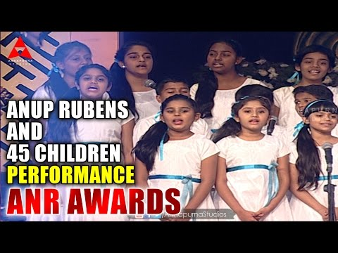 Anup Rubens and 45 Children Live  Perform Manam Movie Song at ANR Awards