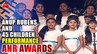 anup-rubens-and-45-children-live-perform-manam-movie-song-at-anr-awards