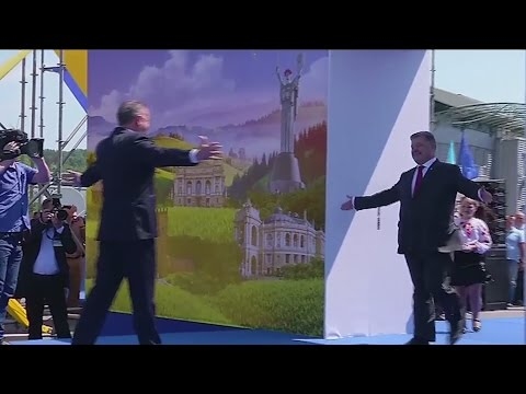 Ukraine celebrates visa-free EU travel by walking through a massive passport