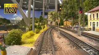 Gambar cover Cab Ride as Train Driver along Mr. Porsche 's Superb Model Railway with Austrian Model Trains