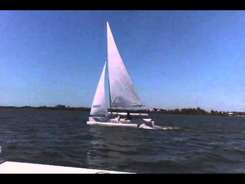 My homemade trimaran at about 12 mph.: My little homemade 16' trimaran