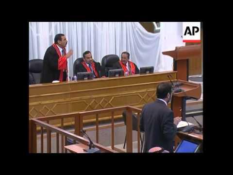 Saddam calls US denials of torture lies as trial resumes