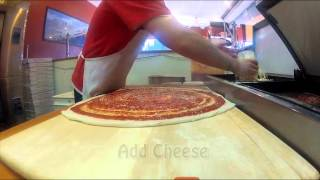 Making a pizza at Burke Street Pizza