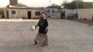 Somalian Girl playing soccer she has serious football skills