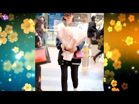 李冰冰机场穿棒球服靓丽 获赠鲜花娇笑萌翻天