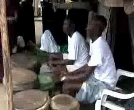 Nigerian Slum Dwellers Dance Under a Bridge