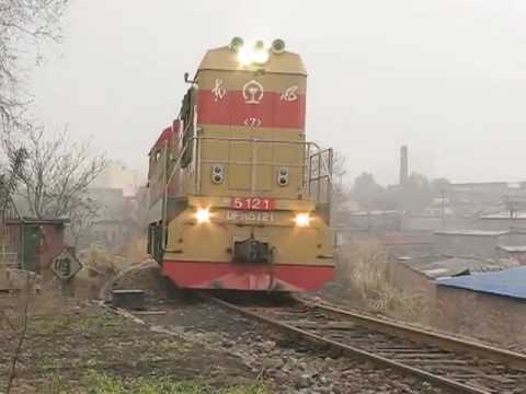 The Chinese railway shunting engine DF7G 5121 push the Freight train at PingDingShan with great horn