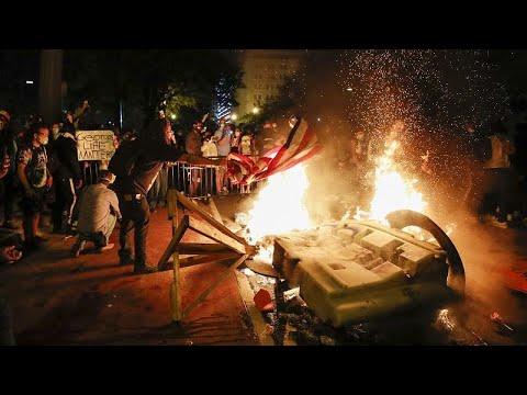 صدامات أمام البيت الأبيض وحظر تجول في مدن أمريكية كبرى