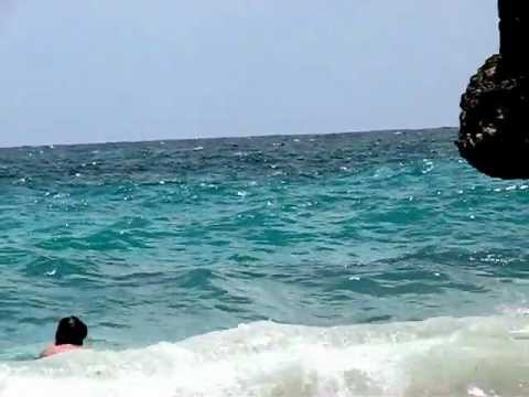 Cliff diving at Barbados Crane Beach