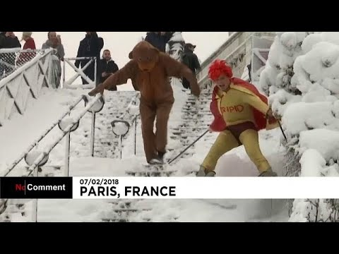 Skiers head to snowy slopes of Paris' Sacre Coeur cathedral