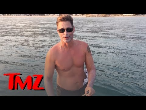 Rob Lowe Paddleboards with 2 Great White Sharks!!!  TMZ