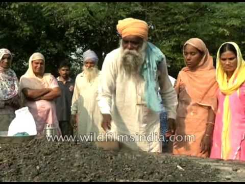 Sikh family collect ashes after cremation of a family member