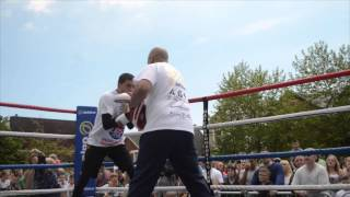 LEE SELBY DEMONSTRATES TO THE CROWD HIS HAND SPEED & FOOTWORK WITH TRAINER TONY BORG