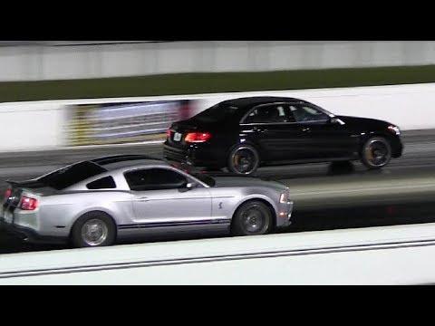 2014 E63 S Model AMG vs Shelby GT500 - 1/4 mile Drag Race Video - Camera w/ Shakes -Road Test TV ®