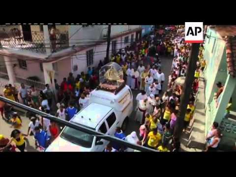 Procession honours island''s patron saint, cardinal on Pope