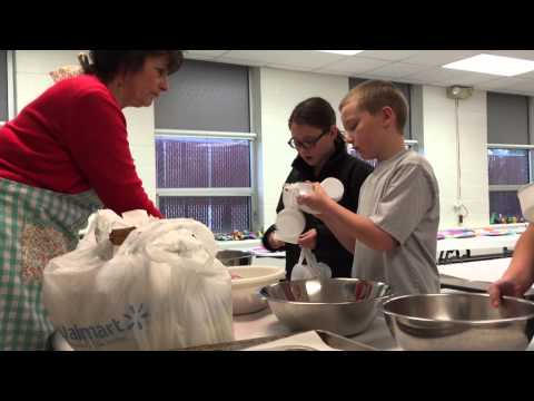 Towanda Elementary School students mix flour for cupcakes