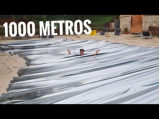 CUBRIMOS la PISCINA de una MANSIÓN con 1000 METROS de PAPEL DE PLATA!! BROMA A YOUTUBERS [Logan G]
