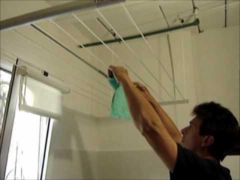 Uso y funcionamiento del tendedero colgante para secar for Colgadores de ropa de pared
