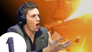 """LUMOS MAXIMA!"" Eddie Redmayne turns on Christmas lights and a furnace(!)"