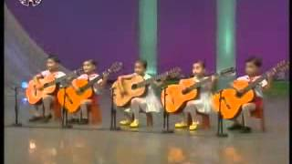 North Korean Kids Play Awsome Guitar (Very Cute and Kinda Creepy)