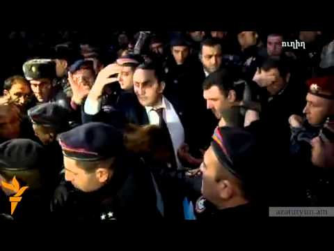Protesters throwing stones at Prosecutor General in Gyumri