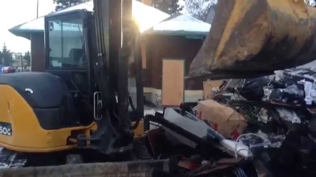 Demolition of garage in Calgary burned out by copper wire