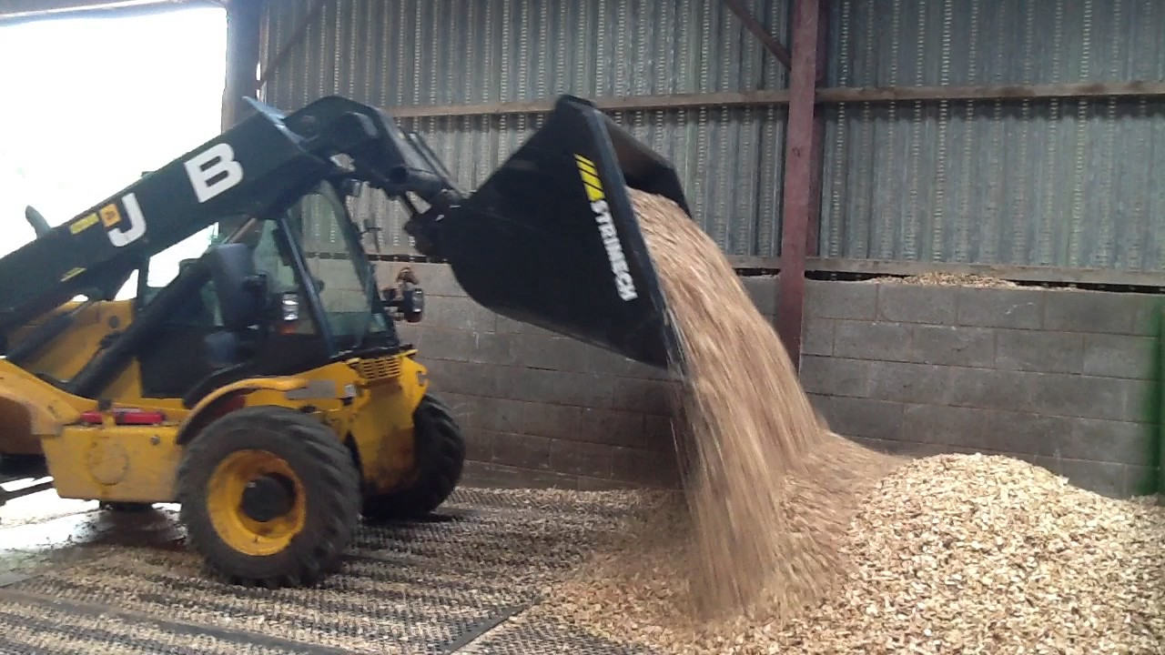 Moving wood chip to drying floor  YouTube