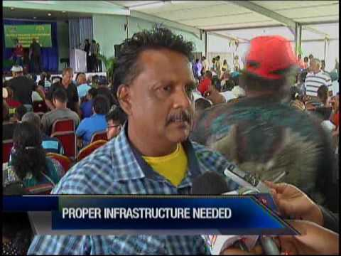 Former Caroni Workers Receive Land Leases