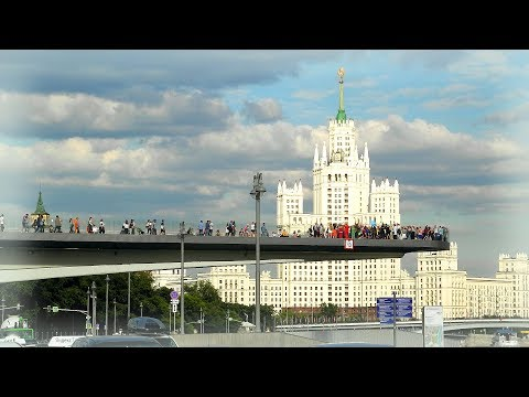Russia, Moscow 2018: Summer walk in Zariadye park. Unique skywalk bridge above Moskva river