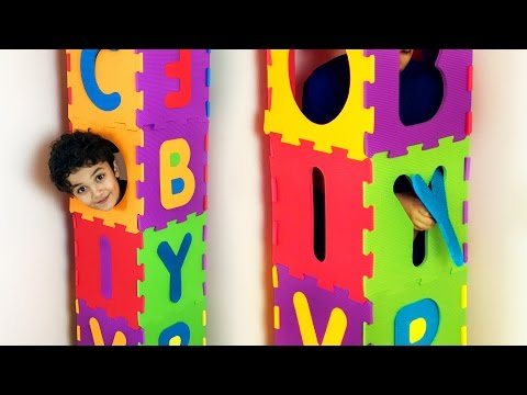 Build a tall tower with squishy ABC foam puzzle for children. Let's Play Kids.