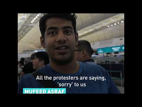 Travelers inside Hong Kong Airport on the protests