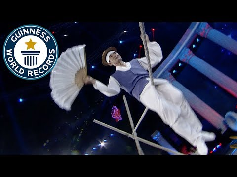 Most 180 degree rotating bum bounces on a tightrope in 30 seconds - Guinness World Records