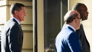 Flynn tells court he intends to plead guilty