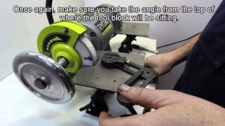 the acute tool sharpening system 10 sharpening a two flute end mill