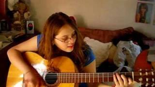 linda playing guitar