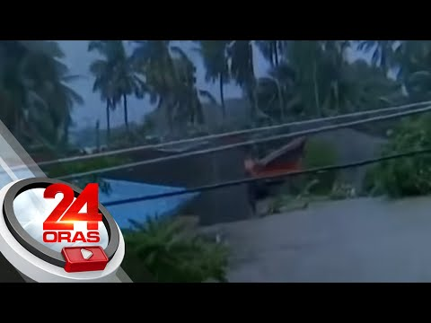 Families in Batangas barangay climb up roofs to escape flood