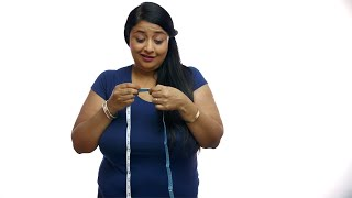 Overweight Indian woman measuring her Belly fat - Obesity concept