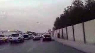 BMW M5 and Porsche Carrera GT drifting through busy road (CRAZY!!!!) Arabs