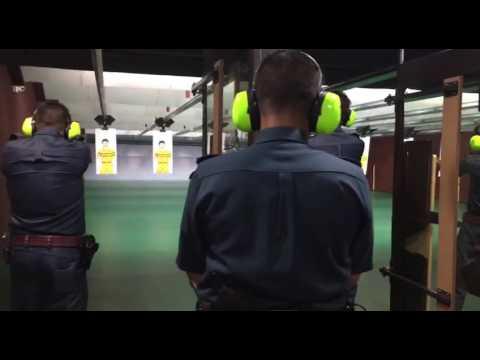 Live-firing training at the Certis Cisco indoor shooting range