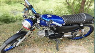 70cc bike modified in blue color cafe racer style