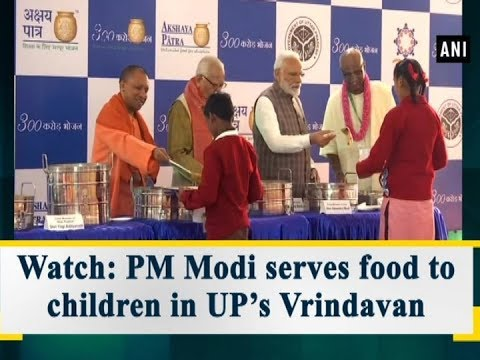 Watch: PM Modi serves food to children in UP's Vrindavan - Uttar Pradesh News